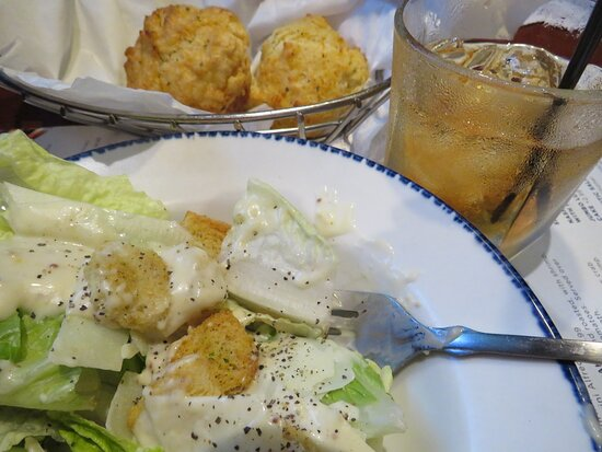 Caesar salad with dressing on the side.