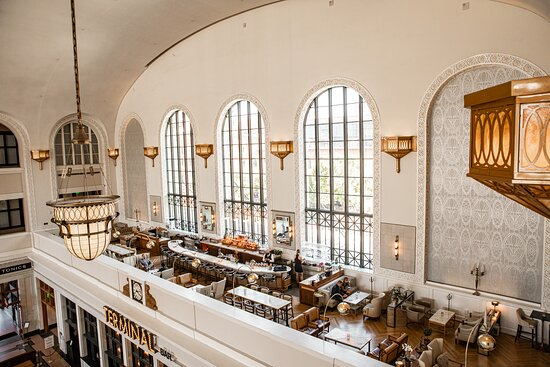 Located on the mezzanine, The Cooper Lounge provides guests with a one-of-a-kind cocktail experience and a stunning bird's eye view of the Great Hall and a soaring perspective of downtown Denver through 28 foot high cast iron windows.