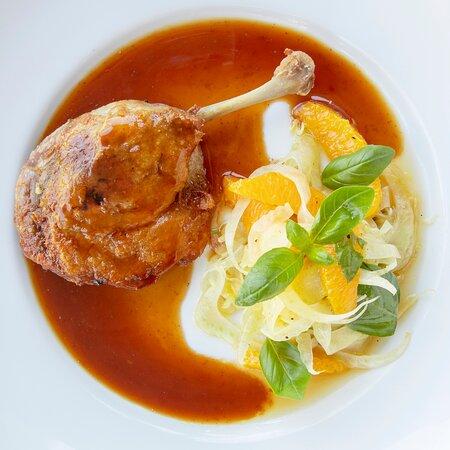 Confit duck leg with a sweet & sour orange sauce with a fennel, orange & basil salad & Jerusalem artichoke, potato & gruyere gratin