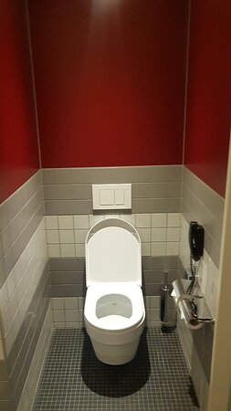The toilet bowl has a visible yellow stain. The floor was sticky when you walk on barefoot.