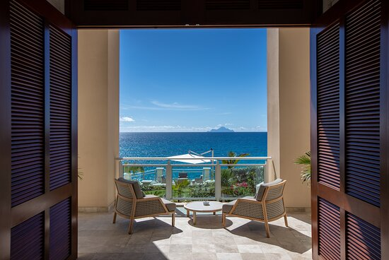 External Lounge Area with a stunning view on the Caribbean sea and Saba Island.