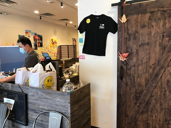 Watchung, NJ: Photo of the take-out server along with T-shirts available for sale. Take-out service is brisk during lunchtime.