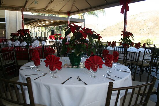 Outdoor dining under a covered patio with views of the course.
