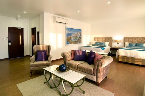 Our Executive Suite had two queen size beds and a living room area, plus a spacious bathroom.