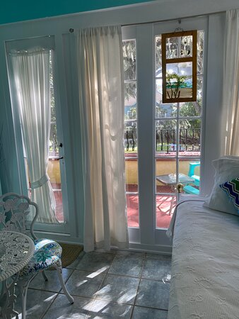 Hibiscus - private terrace. This room has a queen bed & a single w/ trundle. Great for a family.