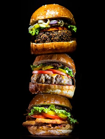The triple tour, chicken burger, barumis' cheeseburger and our veggie burger.