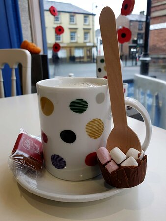 Hot Chocolate, warmed milk with a chocolate and marshmallow stirrer.