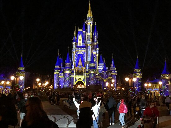 Cinderella's Castle was not lit up during the holidays this year as normal but was illuminated with lasers and the color scheme changed every hour or so.