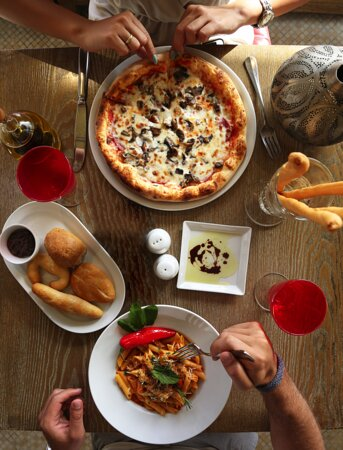 Step into Pane Vino restaurant for a delicious Italian meal of appetizers, pasta and pizzas.