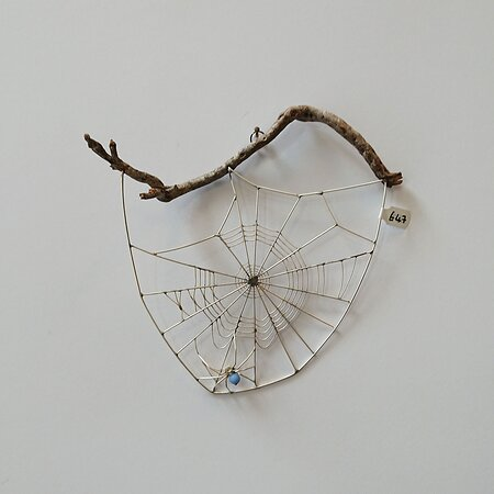 Spiders Web made from silver wire and driftwood by Edinburgh based artist Becka Gauld. Becka's insects are a great gift item and always popular with travellers visiting the gallery.