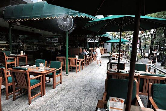 Enjoy Bangkok's vibrant street life from the shaded comfort of The Landmark's Terrace.