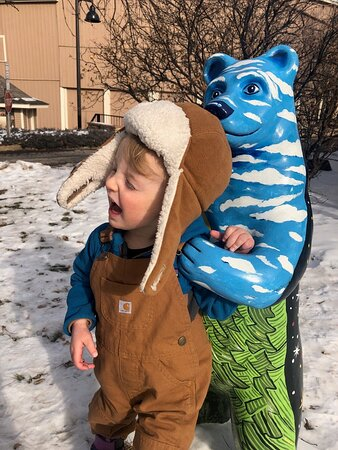 A young visitor enjoying our Art In The Park exhibit supporting Colorado Artists and non profits. This fun installation with accompanying cell phone scavenger hunt will be on the grounds till May 1 2021. Bear Maps available at check in.