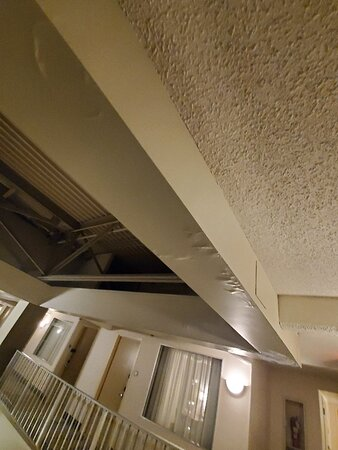 Massive Hole in the Ceiling That Pours Water