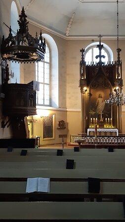 Kyrkans Predikstol till vänster i bild.