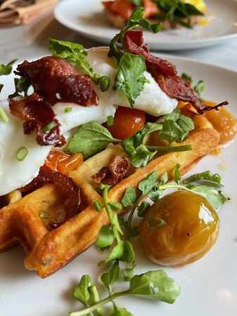 POTATO WAFFLE Topped with watercress, confit cherry tomatoes, scrambled or poached eggs, bacon