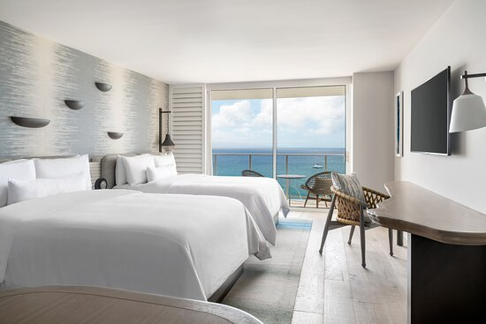 Stay in our spacious Queen/Queen Guest Room with oceanfront views and comfortable amenities.