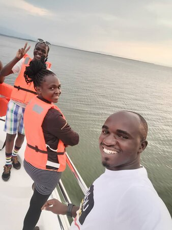 Boat cruise on Kazinga channel. Ronald is in the white T-shirt.
