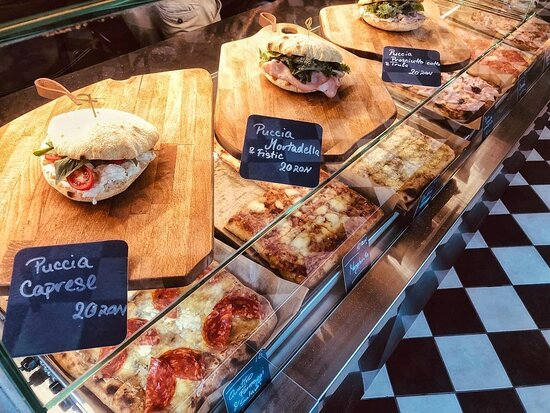 Slices of pizza and puccia to-go.