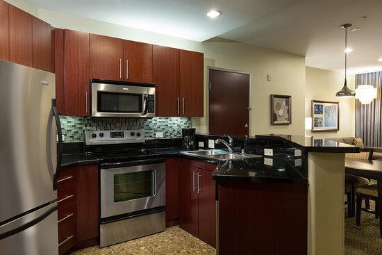 State of the art kitchen with fridge, microwave,& stove with oven.