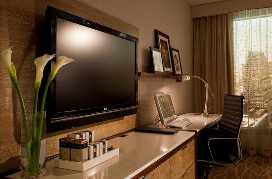 TV, dresser and desk set-up in most guestrooms.