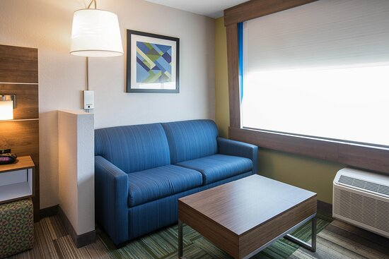 Our Executive Room offers a cozy seating area with sofa sleeper.