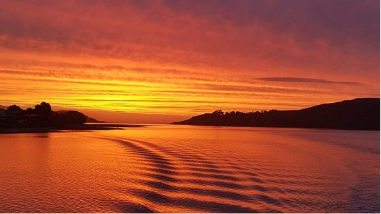 Raglan, New Zealand: Sunset over the Tasman sea and harbour mouth.