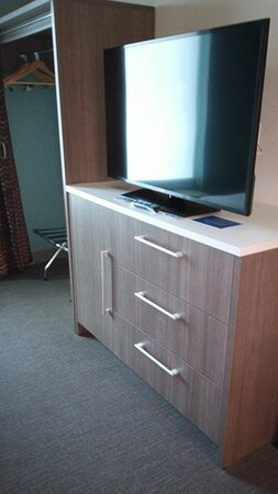 Closet, dresser and TV.