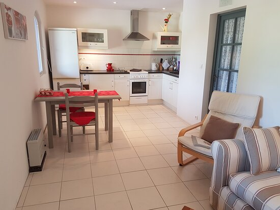 Agnac, France : Gite kitchen/lounge/diner. Quality fittings and accessories including air conditioning & dishwasher.