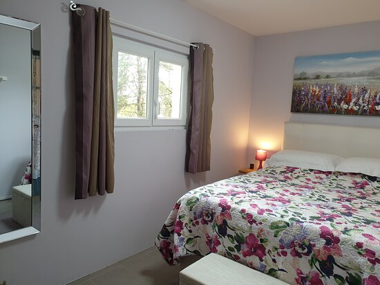 Agnac, France : Gite bedroom with King Size bed and memory foam mattress. Wardrobe with hanging and drawers.