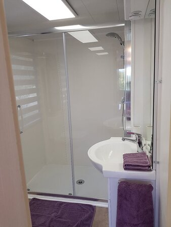 Agnac, France : Static Home large walk-in shower, hand basin and toilet with heated towel rail. Towels provided.