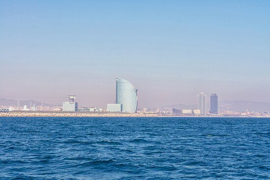 The Barcelona skyline. From your own yacht.