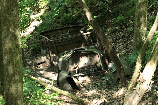 This car wreck is hiding in one of the deep ravines