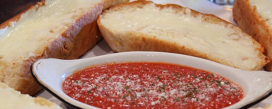Garlic toast with cheese with our delicious dipping sauce you can add for an additional charge.
