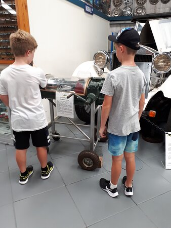 The boys seeing how an old engine works