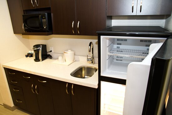 Keurig coffee maker and fridge available in all room