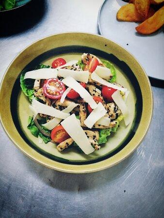 Fresh chicken salad with parmesan shavings.