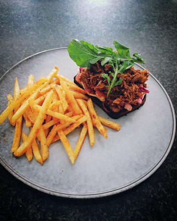 Asian inspired pulled pork with home made kimchi and wasabi mayo, served on our freshly baked bread with skinny fries.