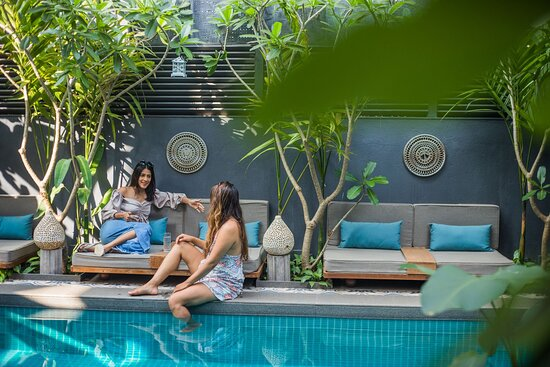 Our lush pool area is perfect for relaxation and conversation.
