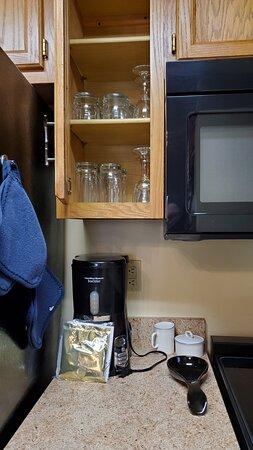 Kitchen cabinets -- glasses, wine glasses, coffee maker