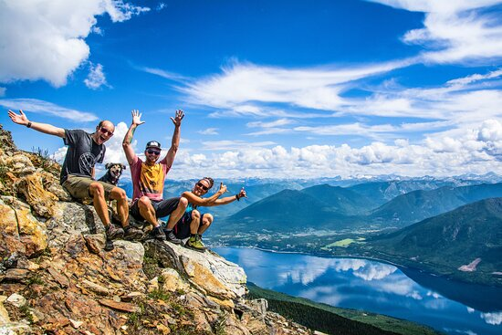 Having fun on Saddle Back Mountain with Nakusp and the Upper Arrow Lakes in the background.