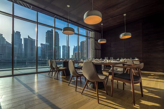 Experience Culinary Excellence Against Inspiring Waterfront Vie