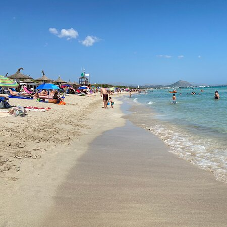 Muro Beach It is located in the nothern part of Mallorca (Spain) facing the island of Menorca. I found this beach exquisite, very clean and peaceful, perfect for the kids as the water is shallow. It is a very long beach,  perfect for those who loves long walks