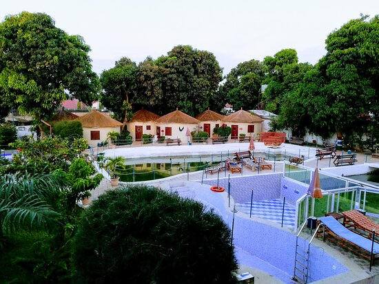 Bijilo, Gambia: View across swimming pool and mini lake