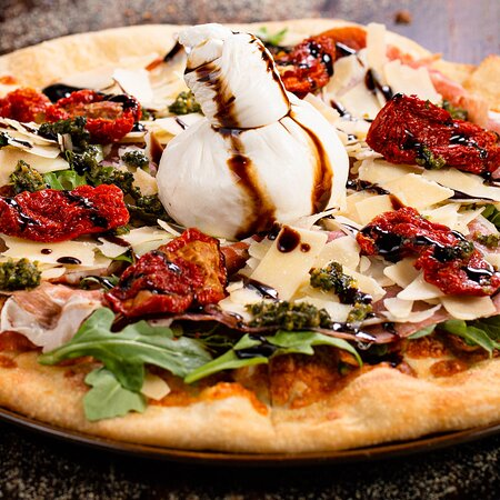 Burrata on pizza = The ultimate cultural reset 😍.  Find it beautiful and 100% fresh on top of our 𝐏𝐢𝐳𝐳𝐚 𝐅𝐨𝐧𝐭𝐚𝐧𝐚🍕.  A flavorful pizza with Fresh Mozzarella Cheese, Arugula, Prosciutto, Shaved Parmesan, Pesto, Balsamic Cream, and Dried Tomatoes.  Visit us today and try it.  Call ☎️️ 305.4709614 to make a reservation or order online at fontanaristorante.com.