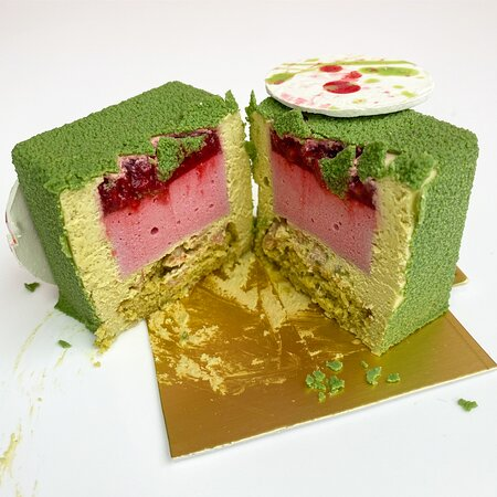 Pistachio (Gluten-Free) It is made of pistachio & white chocolate mousse, raspberry compote, raspberry mousse, pistachio sponge and white chocolate crunch layer. A perfect dessert for intense pistachio & raspberry flavour lovers!