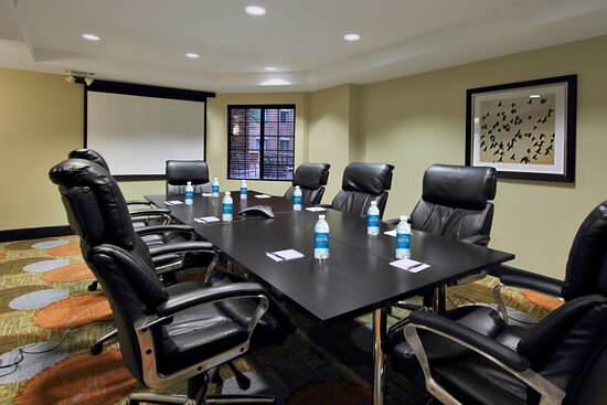 Completely furnished with a dry erase board & flipchart with pads.