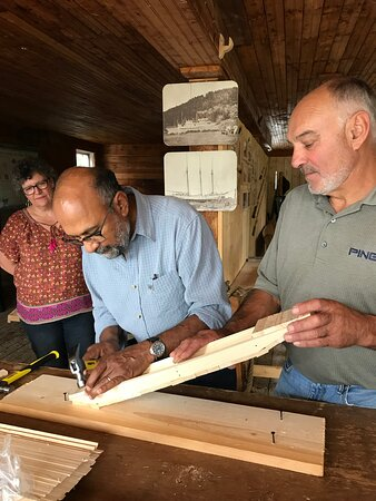 """Sherbrooke Village offers a number of hands-on experiences. Participants here are building a boat, a scaled down """"St. Mary's River Punt."""""""