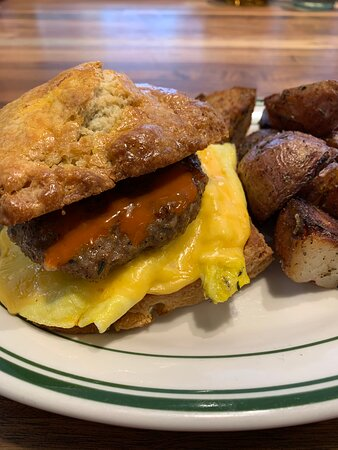 The famous, Goodness Breakfast sandwich. House-made, hand-packed sausage, American cheese, a fried egg, Cholula hot sauce and honey in between a Pieconic Buttermilk Biscuit.