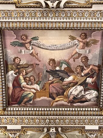 Baptistry. The vault. The charming central panel is by Domenico Crespi, Il Passignano, and features a band of five angels on vocals, organ, lute, violin and flute with others in attendance. A pair of putti hold up the music that they are playing, which is an antiphon in honour of the Immaculate Conception.