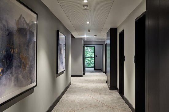 Acoustic ceilings in guest hallways help with sound insulation
